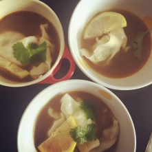Steamed Pork Dumplings served in Beef Broth